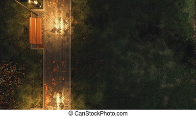 Park walkway with benches at autumn night top view