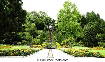 Park with flowers and artificial waterfall on the island of Mainau in Germany. 2017 year.