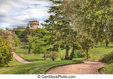 park with medieval castle in Volterra, Tuscany, Italy