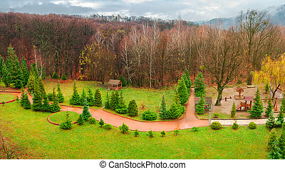 park with playground in autumn. gloomy rainy weather in...