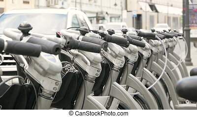 Parked bikes for rent - Handlebars of parked rental bicycles...