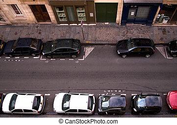 Cars parked in a narrow Parisian backstreet, France