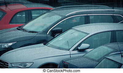 Parked Cars In Rainstorm - Row of cars in strong rainfall