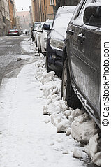 parked cars in snow storm