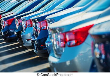 Parked Cars on a Lot. Row of New Cars on the Car Dealer...