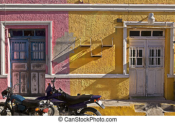 Parked Motorcycles & Pink and Yellow Buildings