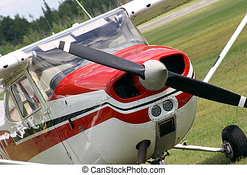 A small engine plane is parked on the airfield.