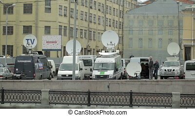 Parked satellite TV van transmits breaking news events to...