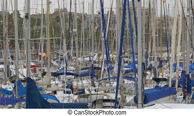 Parked Ships, Boats, Yachts in Rambla del Mar Port of Barcelona, Spain.