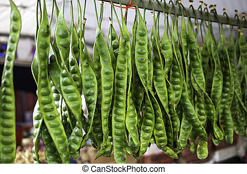 Parkia speciosa bean or bitter bean hanging to sale in Asia ...