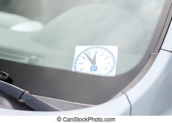 parking clock on car dashboard