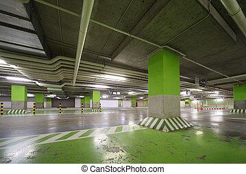 Parking garage of shopping center, underground interior without cars