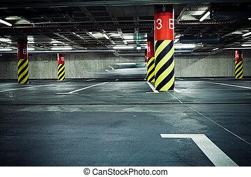 Parking garage underground, blurred car