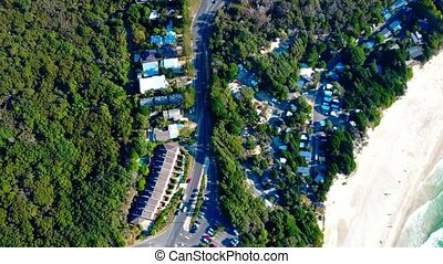 Parking in a small town. Forest. Beach. Aerial top view