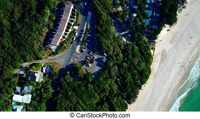 Parking in a small town. Forest. Beach.