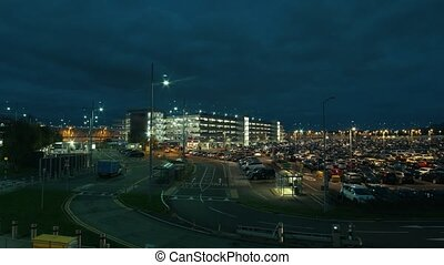 Parking in the airport - night time-lapse, wide angle