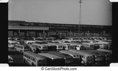 Pan of full parking lot with cars and buses. Florida racetrack. 1930s 1940s.