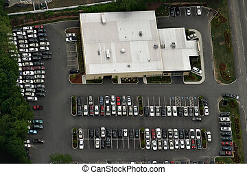 Aerial view of building with parking lot.