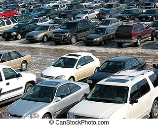 Parking lot in spring. All trademarks, logos and readable license plates are removed.