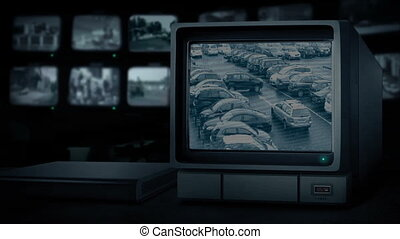 CCTV station with cars driving around parking lot