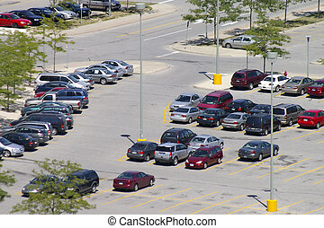 Overhead view of a partially full parking lot.