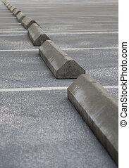 Parking lot - Concrete grey parking stoppers diagonal on...