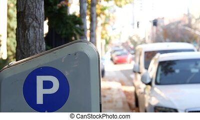 Parking lot sign as symbol of traffic difficulties and ...