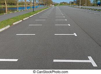 parking lot - empty parking lot at a football stadium