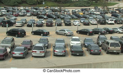 Time lapse of a busy parking lot as cars and people arrive and leave