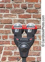 Parking Meter by Brick Wall