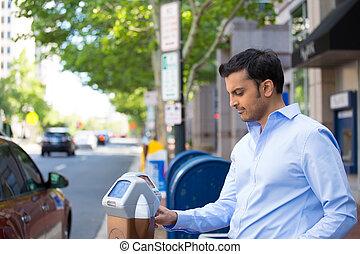 Parking meter - Closeup portrait, young man in blue button...