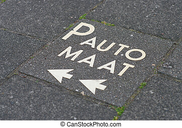 parking meter - text on a sidewalk pointing to the nearest...