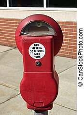 Parking Meter - A red parking meter on the side of a street