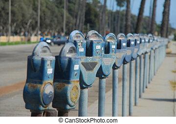 Parking Meter - lots of arking meter in a parking lot