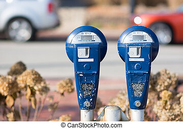 parking meters - blue parking meters with no time on them in...