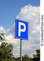 Parking Sign against a blue sky.