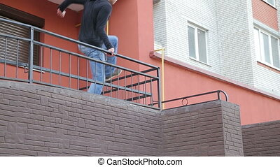 Parkour exercises with stairs of building