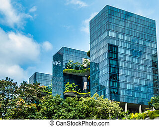 Singapore, Singapore - August  05, 2018:  Parkroyal is a luxury hotel located in the Central Area of Singapore, More than 15.000 square meters of lush vegetation are part of this building. This is part of the growing trend to build more sustainable buildings that have less impact on the environment.