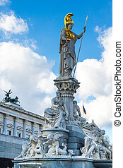 Parliament building in Vienna, Austria and statue of Pallas Athena Brunnen