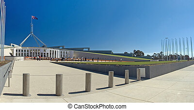 Parliament House in Canberra, visitors in distance, clear blue sky