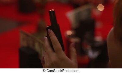 parlor game Mafia gun in the hands of Member