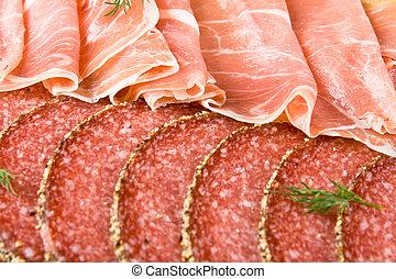 Parma ham and salami slices
