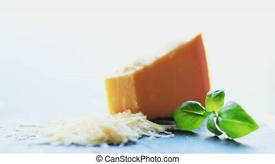 Parmesan cheese and basil leaf as shredded recipe ingredient, food and cooking concept