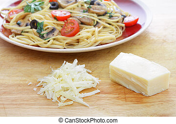 Parmesan cheese and pasta - Parmesan grated from a wedge of...