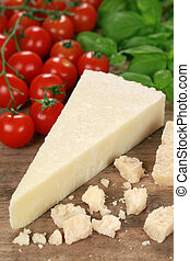 Parmesan cheese decorated with tomatoes and basil
