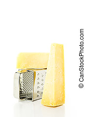 Parmesan cheese - Slice of parmesan cheese on the board.