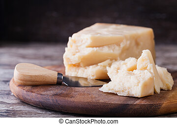 Parmesan cheese - the parmesan cheese on cutting board