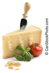 Parmesan cheese with basil and tomato - chunk of parmesan...
