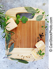 Parmesan cheese with herbs, top view