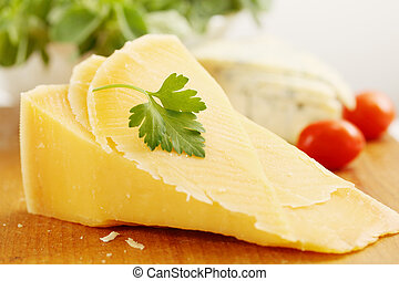 parmesan cheese with tomatoes - a large piece of Swiss...
